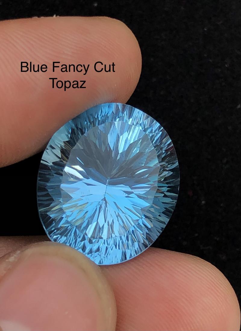 Laser Cut 36 ct Top Class Blue Topaz Ring Size