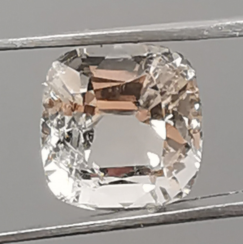 Topaz, 6.315ct, cushion cut stone waiting for a new owner!