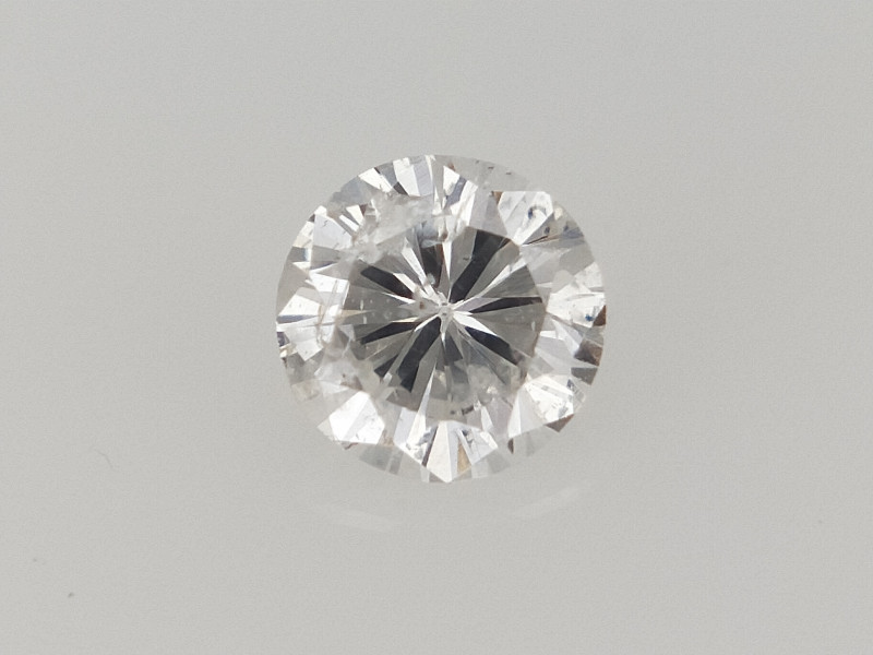 0.10 CTS , Round Brilliant Cut , Light Colored Diamond