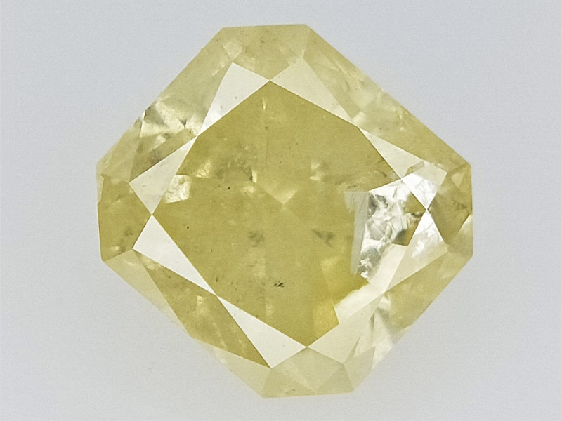 0.62 cts  Natural Yellow Diamond , Brilliant Cut Diamond