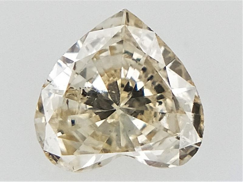 0.11 cts   , heart brilliant Cut Diamond , Natural Champagne diamond