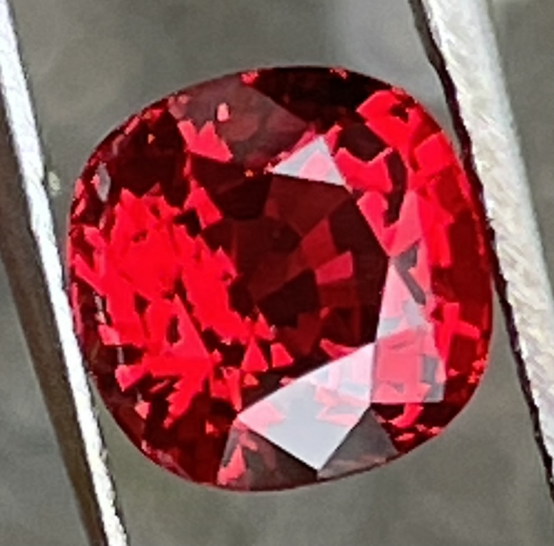 Bright red spinel.   Photos and video taken on rain day outside.