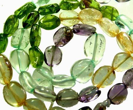 FOUR DIFERENT  COLOURFUL STONES  IN STRAND 69.60 CTS GT 1558