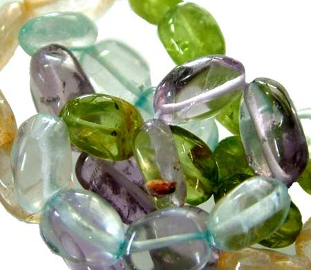 FOUR DIFERENT  COLOURFUL STONES  IN STRAND 73.00 CTS GT 1568