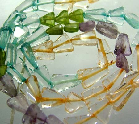 FOUR DIFERENT  COLOURFUL STONES  IN STRAND 54.10 CTS GT 1569