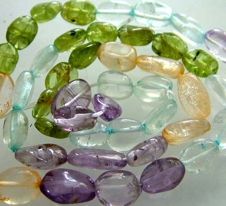 FOUR DIFERENT  COLOURFUL STONES  IN STRAND 68.90 CTS GT 1599