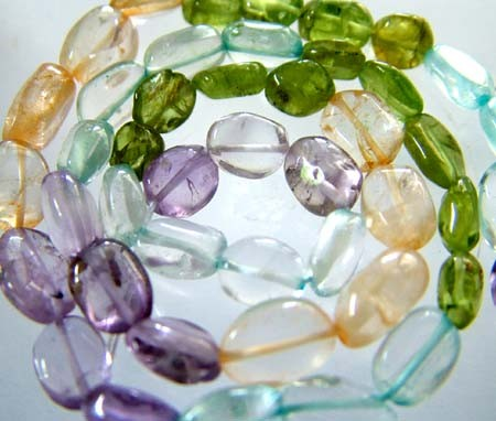 FOUR DIFERENT  COLOURFUL STONES  IN STRAND 68.95 CTS GT 1602