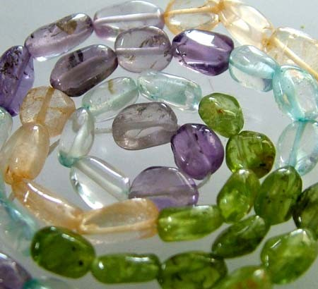 FOUR DIFERENT  COLOURFUL STONES  IN STRAND 68.40 CTS GT 1606