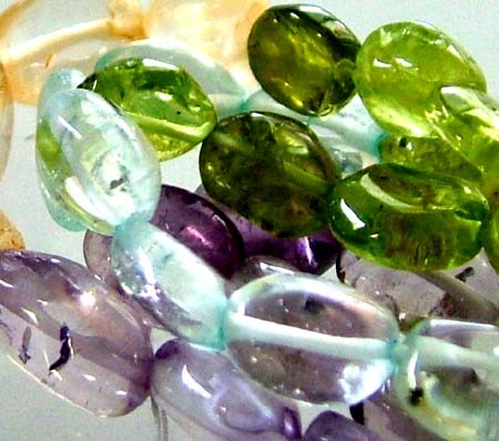 FOUR DIFERENT  COLOURFUL STONES  IN STRAND 68.00 CTS GT 1607