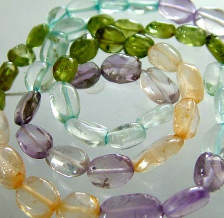 FOUR DIFERENT  COLOURFUL STONES  IN STRAND 72.00 CTS GT 1608