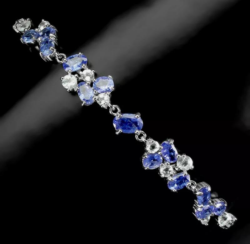 (78) Mesmerizing $1250 Natural 70.2tcw. Tanzanite Bracelet Untreated