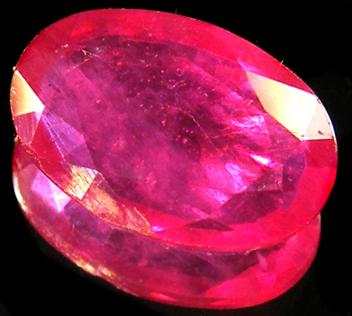 CERT EYE CLEAN RASBERRY RED RUBIES 3.12 CTS 0330