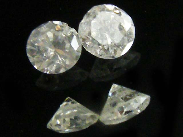 PAIR SI1 SILVER DIAMOND .123 CARATS 2.5 POINTERS   OP1422