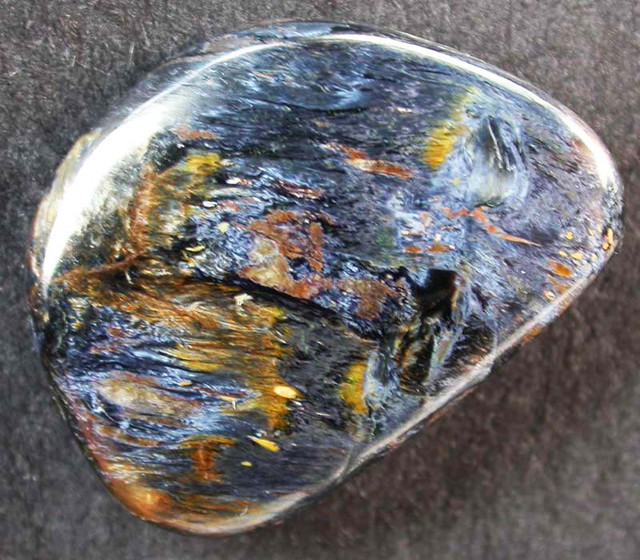 SHIMMERING PIETERSITE CABACHON FROM CHINA 13.55 CTS [MX9718]