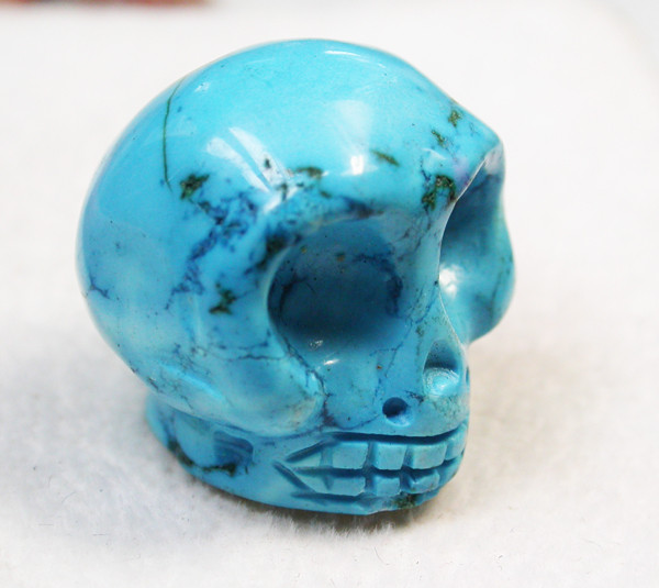 68.30 CTS  TURQUOISE LIKE SKULL CARVING [MGW147]