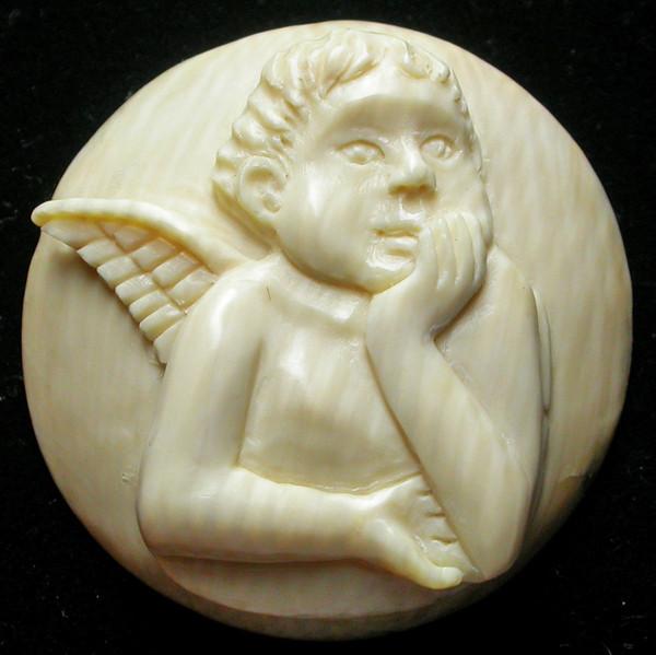 """ANGEL BOY"" MAMMOTH CARVING 25.10 CARATS  RT 459"
