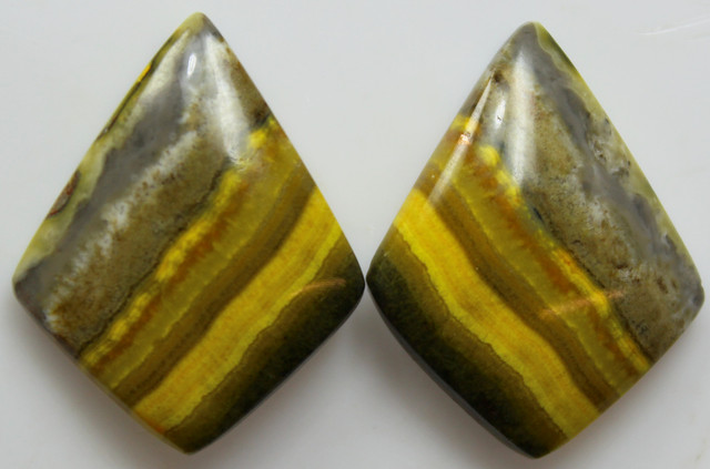 26.15 CTS MUSTARD JASPER PAIR CABOCHONS FROM INDONESIA