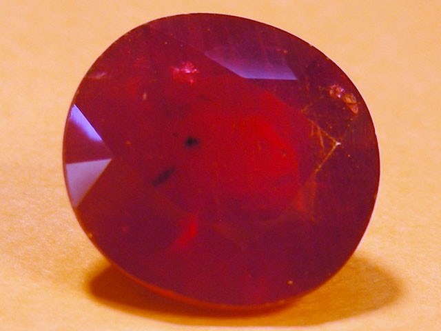 CERT 5.6 CTS FACETED  RED RUBY  11 945