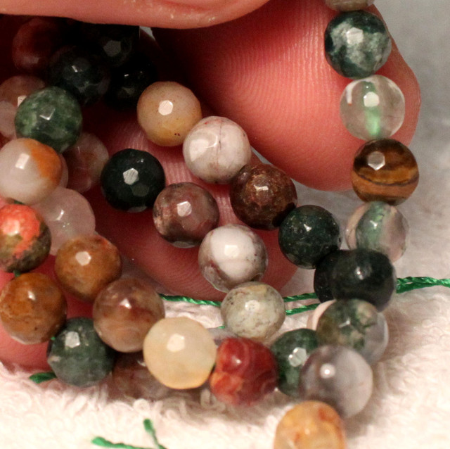 101 Tcw. Indian Agate Strand, 6mm Faceted, 15 1/4 Inches