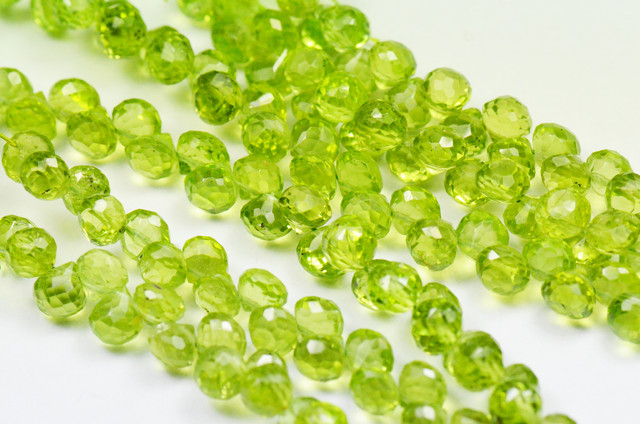"PERIDOT BRIOLETTES onion shape 5mm by 5mm 9"" line 66 gems"