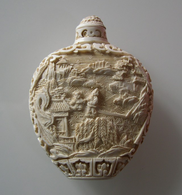 FROM A COLLECTION NICE CARVED SYNTH. CINABAR SNUFF BOTTLE