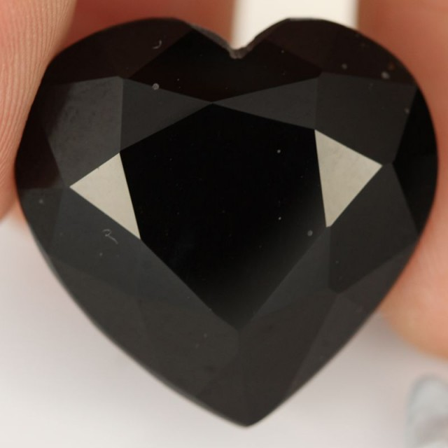 30.95 CTS OBSIDIAN NATURAL GLASS [ST8774]