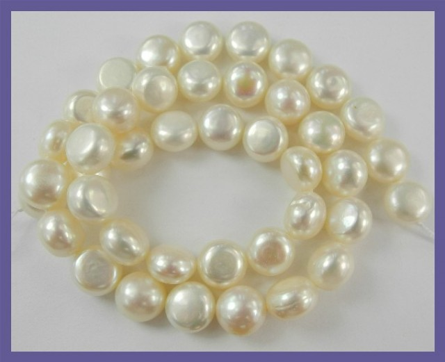 AA QUALITY CREAMY WHITE 10MM OBLATE/BUTTON FRESHWATER PEARL STRAND