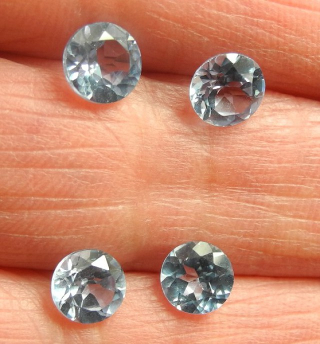 A PARCEL OF 4, 6.00MM, SPARKLING SKY BLUE ROUND TOPAZ GEMSTONES