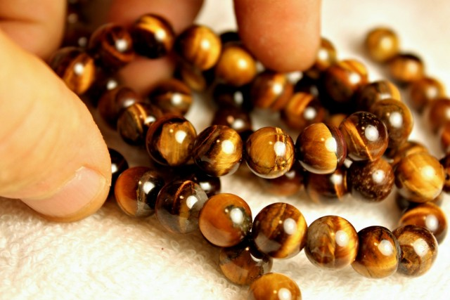 546 Tcw. - 29 Inches Natural China Tiger Eye Strands - Gorgeous