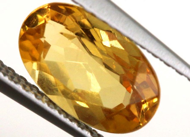 1.60 CTS PEACHY GOLD TOPAZ FACETED STONE PG-1725