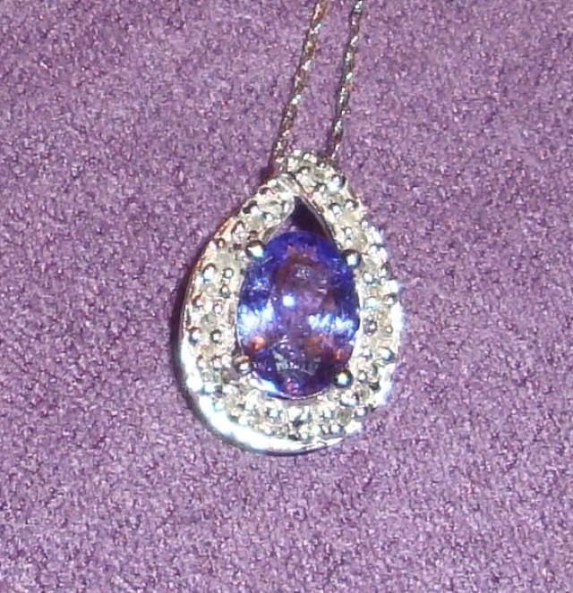 1.10 ctw tanzanite and diamond pendant in 10 ct. white gold