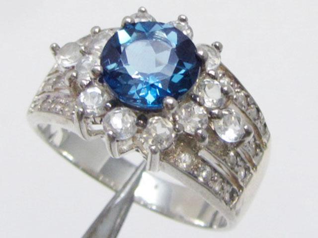 Topaz Blue set in silver ring size 13.5  MJA 824
