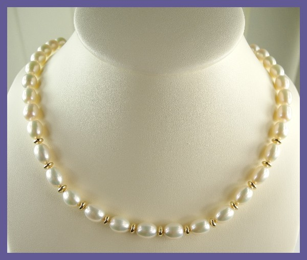 AAA GOLDEN CREAMY  7.00X9.00MM RICE PEARL STRAND W/GF BEADS