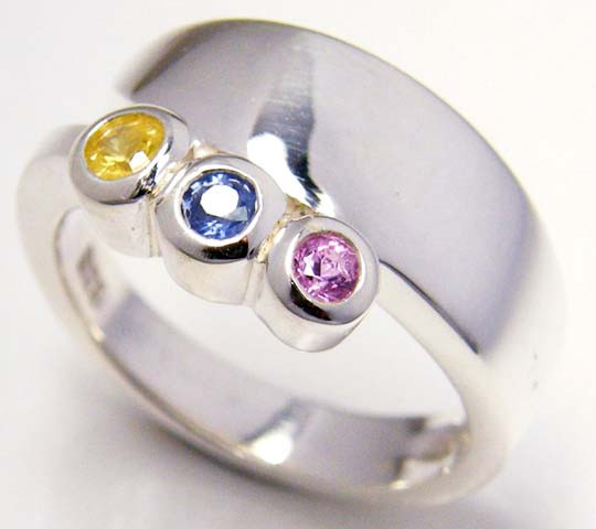 PARTY SAPPHIRES IN STERLING SILVER RING SIZE 7.5  GTJA 60