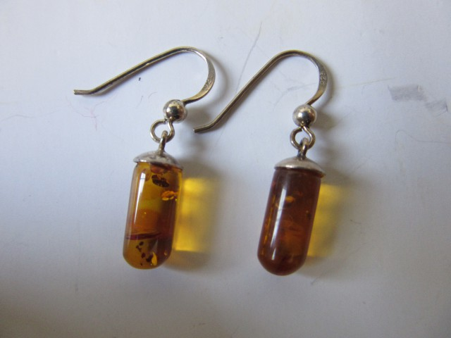 7.7cts polished amber earringsAGR671
