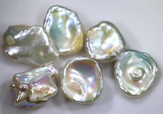 27.40 CTS PEARL STONE (PARCEL) DRILLED ADG-1445
