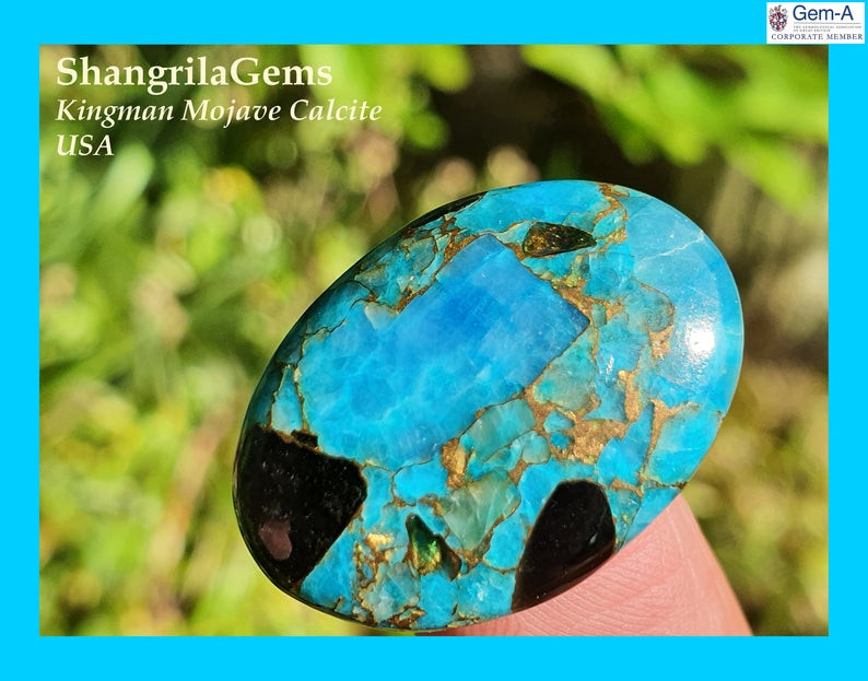 26mm blue mojave calcite cabochon oval 26 by 19 by 4.5mm 20ct