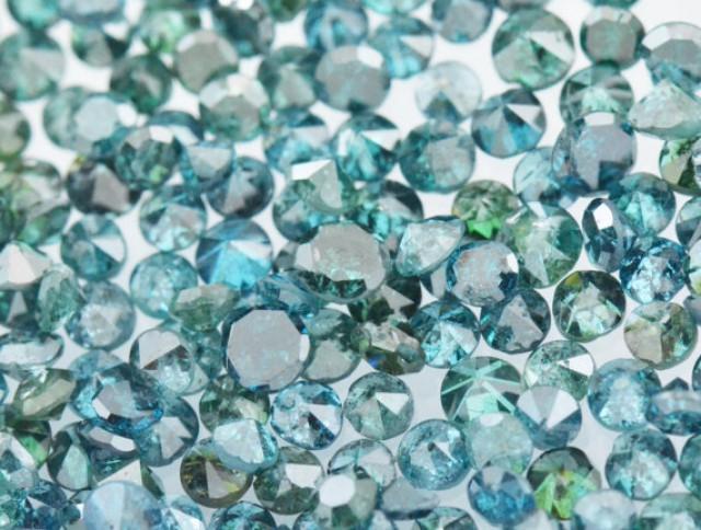 0.25ct  Blue Diamonds brilliant cut round 9 diamonds approx