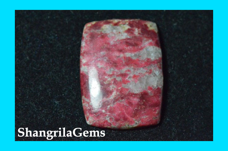 38.5mm 58.75ct Thulite cabochon or pink/red zoisite
