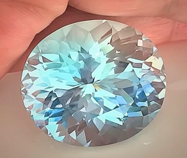 66.04ct Certified Blue Topaz - Custom Cut, Rare Stone, Great Beauty VVS