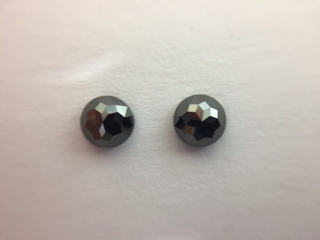 0.64 ct. Black Diamond Pair of Round Rose cut shape one side polished.