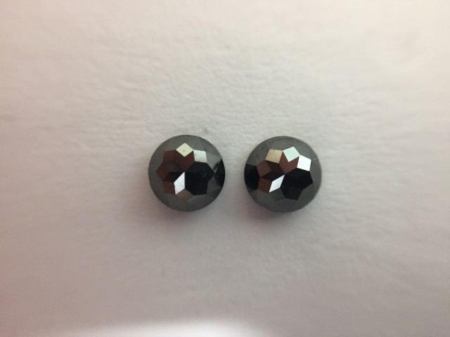 0.65ct. Black Diamond Pair of Round rose Cut shape one side polished