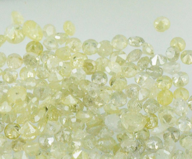0.25ct light yellow champagne brilliant cut round 7 diamonds approx