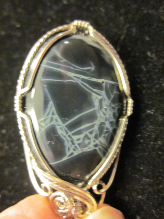 75 carat Graveyard Plume Black Jade sterling silver wire wrapped pendant