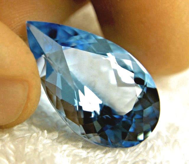 CERTIFIED - 38.789 Carat IF/VVS1 Vivid Blue South American Topaz