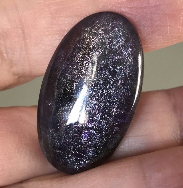 24.70ct IOLITE CABOCHON WITH SCHILLER FLECK EFFECT