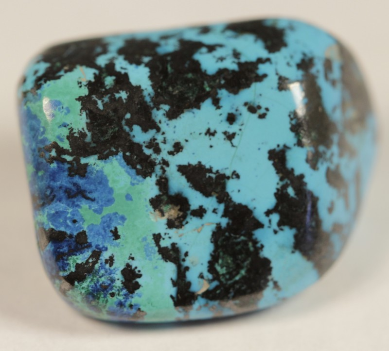 Pretty and rare mix of chrysocolla tenerite with some green turquoise and navy blue azurite.