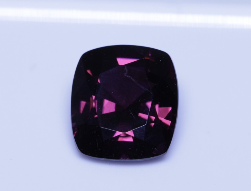 Nice red magenta spinel.  Says red in the cert but it's more magenta to me.