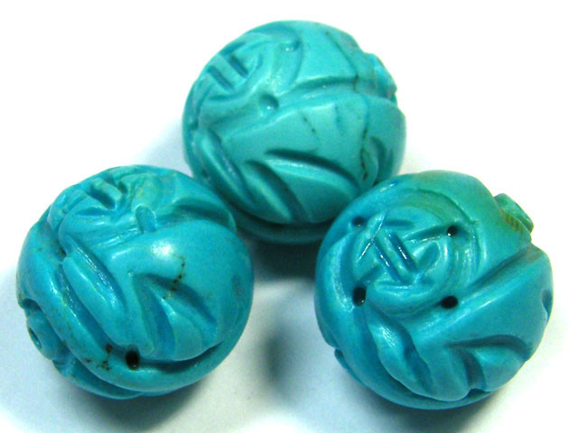 PARCEL TORQUOISE HAND CARVED BEADS 69.50 CTS SGS 80