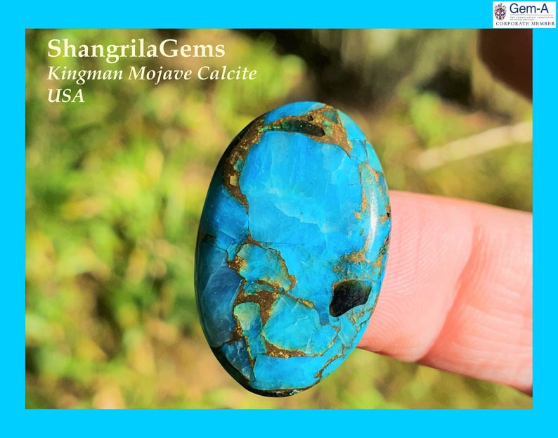 27mm blue mojave calcite cabochon oval 27 by 17 by 4mm 19ct